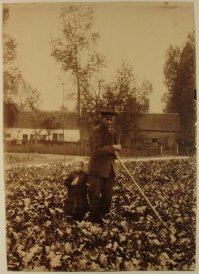 Landarbeider met kind